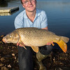 Joe McCall holds a double figure Durleigh Reservoir carp at the dam end.
