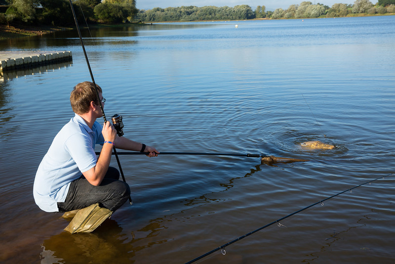 Joe McCall nets a double figure Durleigh reservoir carp at the dam end.