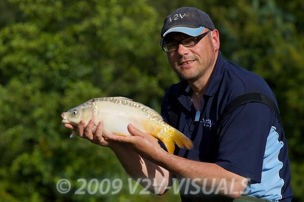 Brian Gay with a 4 lb ghost mirror carp. Greenridge Farm, nr Romsey, Hants. UK © 2009 Brian Gay