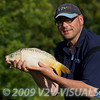 Brian Gay with a 4 lb ghost mirror carp. Greenridge Farm, nr Romsey, Hants. UK © 2009 Brian Gay