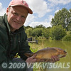 Les Thorne with a colourful common carp from Canal 2 at Greenridge Farm, nr Romsey, Hants. UK © 2009 Brian Gay