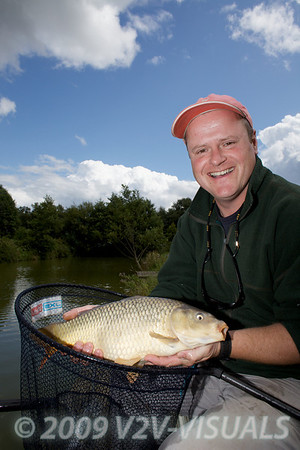 Les Thorne with a nice common carp caught on freelined bread under a long pole from Canal 2 at Greenridge Farm, nr Romsey, Hants. UK © 2009 Brian Gay