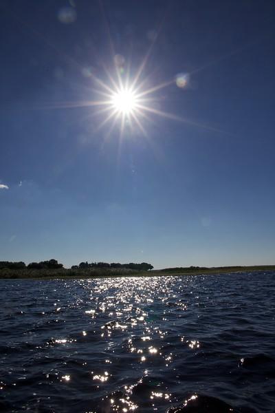 Sun shines over Lake Toho, Florida.