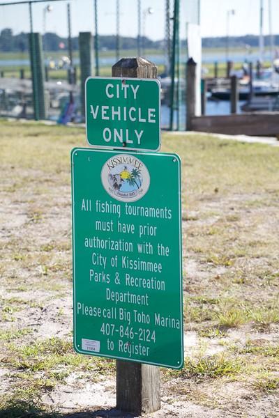 Official signs on the Big Toho Marina dock ramp.