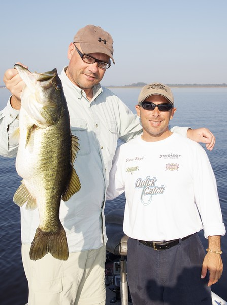 Brian Gay and professional bass fishing guide Steve Boyd, with a 7lb-plus largemouth bass.