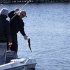 Professional bass guide Steve Boyd (wearing cap) and Oliver Gay bringing a bass to the boat.