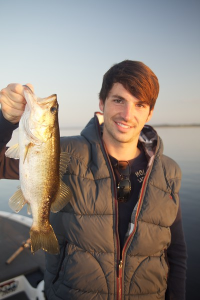Will Morrison with a small freshwater largemouth bass. © 2010 Brian Gay