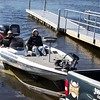Professional bass guide Steve Boyd (wearing cap) and Oliver Gay bringing the boat onto the ramp.