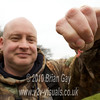 Tony Latter shows the double red maggot hook bait. © 2010 Brian Gay