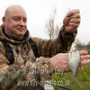 Tony Latter displays a small skimmer bream. © 2010 Brian Gay