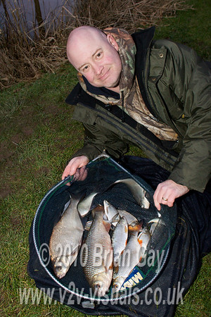 Tony Latter displays a catch including roach to 1 lb 12 oz and skimmers to 1 lb 8 oz.  © 2010 Brian Gay