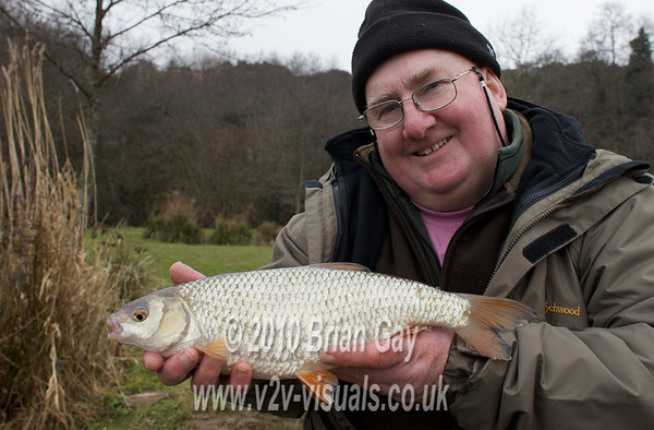 Eric Bunting with a 2 lb Milemead roach. © 2010 Brian Gay