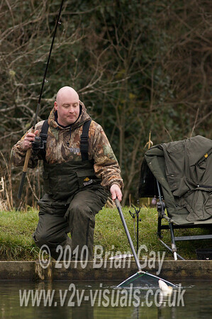 Tony Latter nets a big roach.  © 2010 Brian Gay