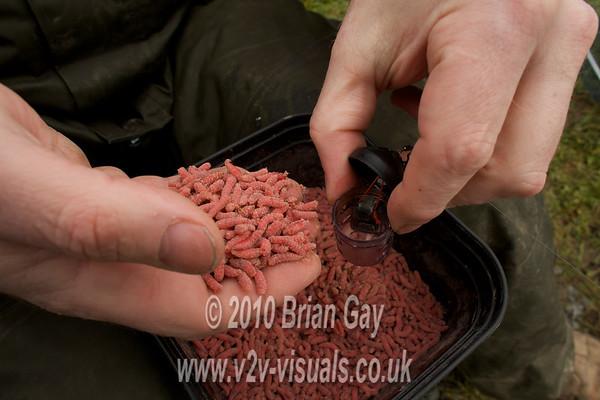 Filling the Kamasan Black Cap feeder with red maggots. © 2010 Brian Gay
