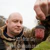Tony Latter shows off the red maggot filled Kamasan Black Cap feeder. © 2010 Brian Gay
