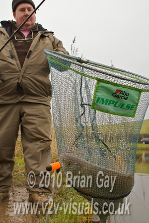 Eric Bunting with a 2 lb roach in the net from the Carp Lake at Milemead, tavistock, Devon. © 2010 Brian Gay
