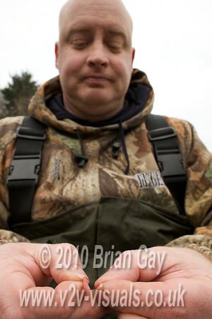 Tony Latter hooking red maggots. © 2010 Brian Gay