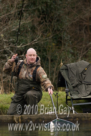 Tony Latter nets a big roach.  © 2010 Brian Gay