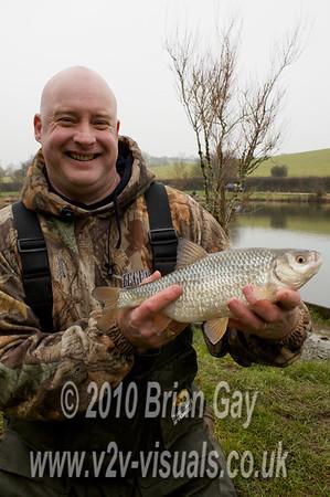 Tony Latter displays a big roach.  © 2010 Brian Gay