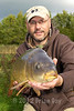 Brian Gay displays a 14 lb 8 oz common carp caught on a maggot clip rig in the margins at Milemead Specimen Lake at Tavistock Devon. © 2012 Brian Gay
