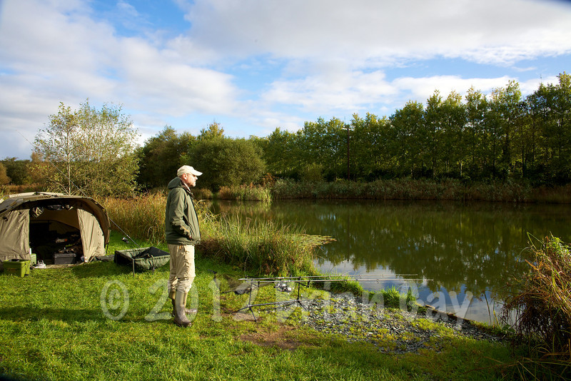 Waiting for a run at Milemead Specimen Lake in between the showers at the start of the second day. © 2012 Brian Gay