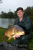 Venue regular Kev Quinn with a 27 lb 8 oz mirror caught on a misshaped Cell boilie from peg 3 on the Milemead Specimen Carp Lake. © 2012 Brian Gay