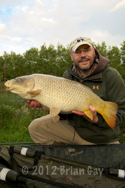 The hotspot delivered again with on the last cast of the session as Brian Gay displays an 18 lb ghost carp that fell for two buoyant plastic red maggots on a KD rig. © 2012 Brian Gay