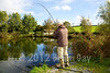 Mid afternoon and the actions starts again - Brian Gay plays a 14 lb common carp at peg 1 on the Milemead Specimen Lake. © 2012 Brian Gay