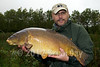 Result Brian Gay with the first fish of the session first cast after about 2.5 hours produced a superb 26 lb 4 oz mirror carp caught on the maggot clip rig and five dead red maggots over the Krill and loose dead red maggots. This is the biggest carp I have matted since i started specimen style carp fishing a year ago. © 2012 Brian Gay