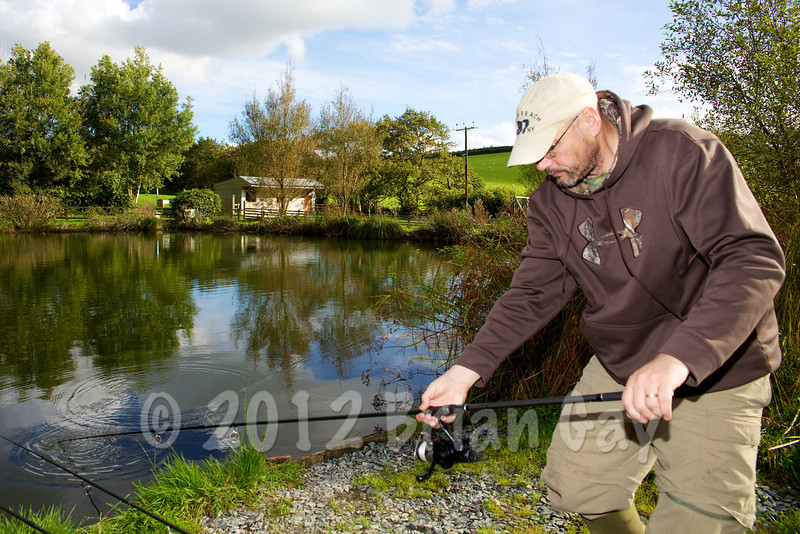 Sinking the line after casting a rig to the productive corner margin. © 2012 Brian Gay