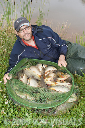 I had to use my Korum Specimen spoon for the catch shot, I hadn't counted the total numbers of fish, although in several test half hour spells my pal Slim who was watching reckoned I was putting around 20 lb in the net. In the end there was around 100 lb of fish in the net. © 2009 Brian Gay