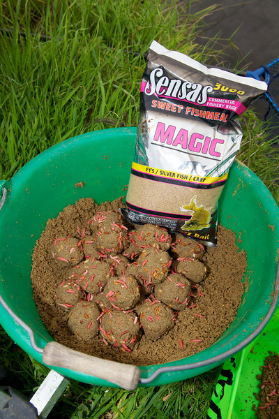 25 balls of groudbait laced with dead red maggots and casters, in a bucket ready for catapulting onto the feeder line of the River huntspiull at Gold Corner. the mix - Fishemal and Magic from Sensas. © 2011 Brian Gay