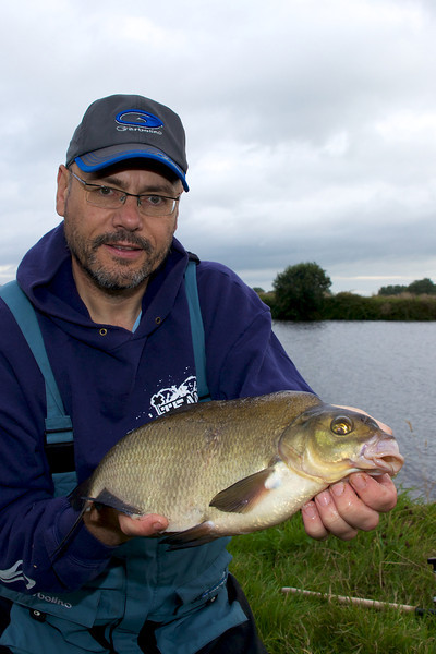 Brian Gay with his first bream of the day a nice  3 lb-plus slab. © 2011 Brian Gay