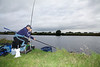 Stretching to net the first bream of the day .© 2011 Brian Gay