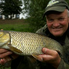 Chris Ponsford with his largest chub from his session on the River Tone. © 2014 Brian Gay