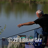Jamie Coook throwing bait into the margins during the top kit challenge at the Sedges, Bridgwater, Somerset. © 2011 Brian Gay