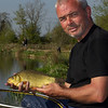 Jamie Cook, poses with a decent crucian carp caught during the top kit challenge at the Sedges, Bridgwater, Somerset. © 2011 Brian Gay