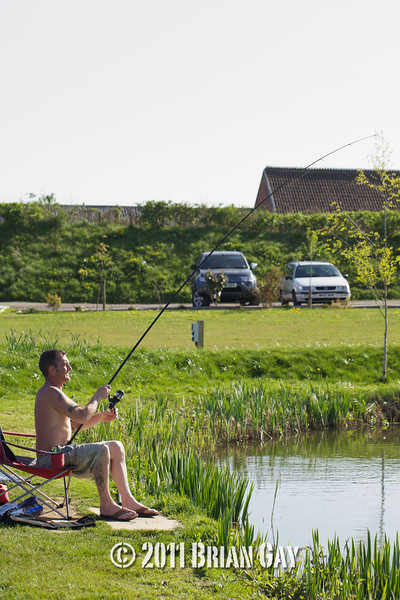 Travis Robinson playing a fish on the Tile pond at The Sedges, Bridgwater, Somerset. © 2011 Brian Gay