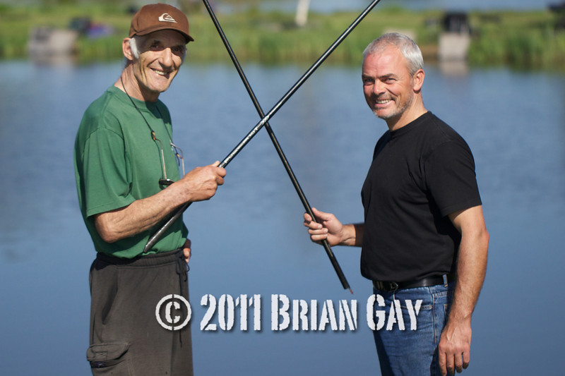 Brian Gatiss and Jamie Cook, before their top kit challenge on the Tile Pond at the Sedges, Bridgwater, Somerset. Holding top kits 'cross swords' style. © 2011 Brian Gay