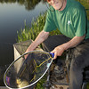 Brian Gatiss displays a common carp caught during the top kit challenge at the Sedges, Bridgwater, Somerset. © 2011 Brian Gay