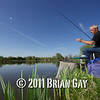 Jamie Cook swings in a small silver fish during the top kit challenge at the Sedges, Bridgwater, Somerset. © 2011 Brian Gay