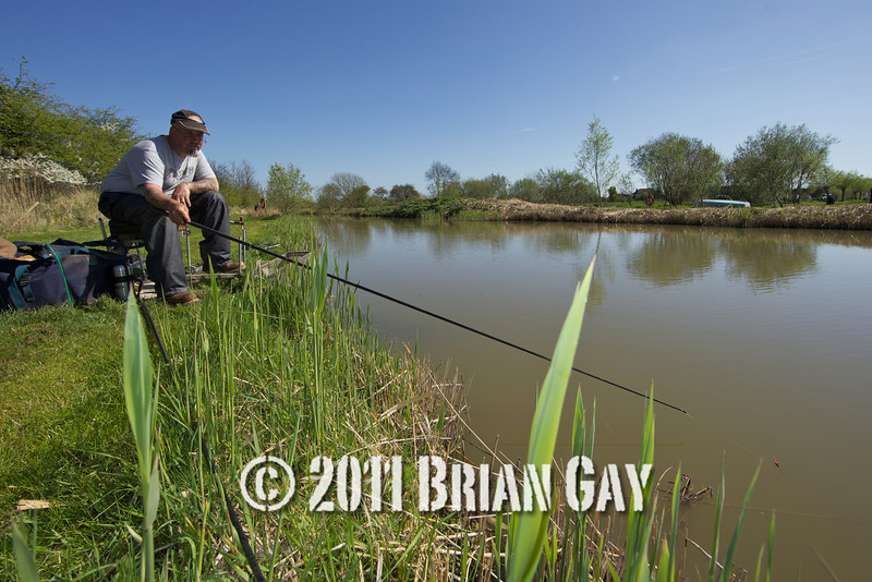 Dave Harlow from Tring, Herts. Fishing the nearside margins on the North bank of the Sedges Canal, Bridgwater, Somerset with just the top two kit of his pole.