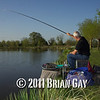 Jamie Cook holds the top kit as a decent fish stretches the elastic during the top kit challenge at the Tile pond, Sedges, Bridgwater, Somerset. © 2011 Brian Gay