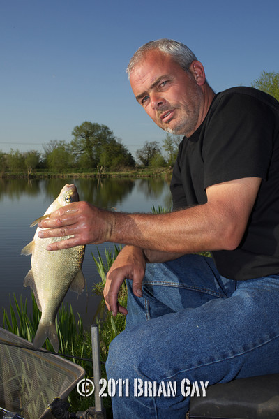 Jamie Cook, poses with a skimmer bream caught during the top kit challenge at the Sedges, Bridgwater, Somerset. © 2011 Brian Gay