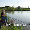 Brian Gatiss looks on as Jamie Cook nets a fish during the top kit challenge at the Sedges, Bridgwater, Somerset. © 2011 Brian Gay