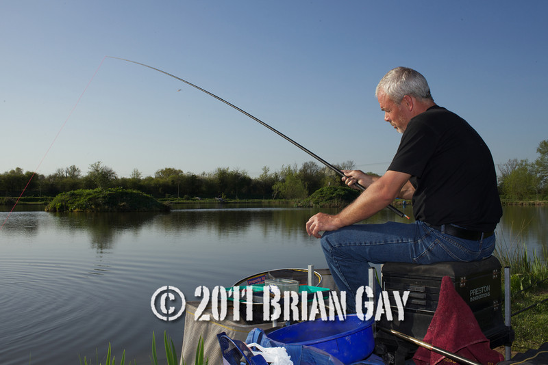Jamie Cook holds the top kit as a decent fish stretches the elastic during their top kit challenge at the Tile pond, Sedges, Bridgwater, Somerset. © 2011 Brian Gay