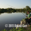 Brian Gatiss plays a carp during the top kit challenge at the Sedges, Bridgwater, Somerset. © 2011 Brian Gay