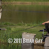 Brian Gatiss fishing a top kit in the margins on the causeway bank of the Tile pond at the Sedges, Bridgwater, Somerset. © 2011 Brian Gay