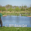 Brian Gatiss and Jamie Cook, before their top kit challenge on the Tile Pond at the Sedges, Bridgwater, Somerset. 'On Guard' sword fight pose.  © 2011 Brian Gay
