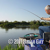 Jamie Cook holds the top kit as a decent fish stretches the elastic and swirls on the surface during the top kit challenge at the Tile pond, Sedges, Bridgwater, Somerset. © 2011 Brian Gay